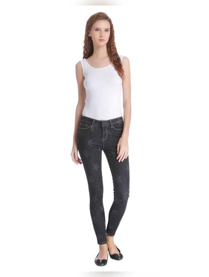 Black Mid Rise Star Print Skinny Jeans