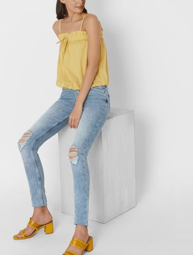 Light Blue Mid Rise Ripped Skinny Jeans
