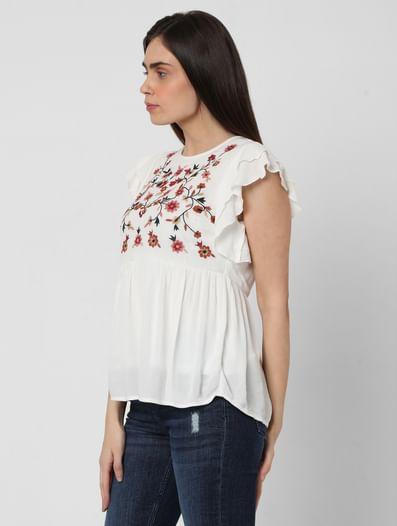 White Embroidered Peplum Top